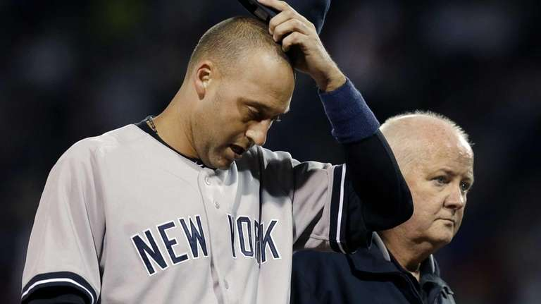 Derek Jeter leaves a game against the Red