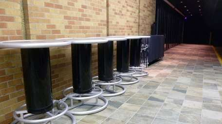Tables and gates are placed outside a night