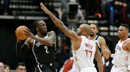 Nets forward Taurean Prince (2) looks to pass