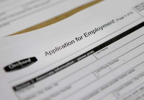 Job applications during a hiring fair for the