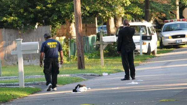 Suffolk County police investigate the scene of a