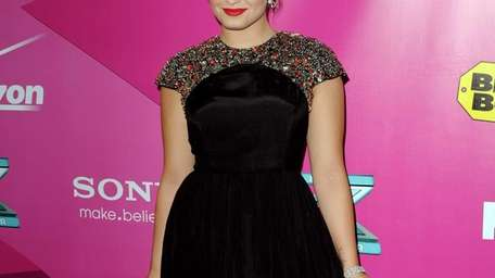 Singer Demi Lovato arrives at the premiere of