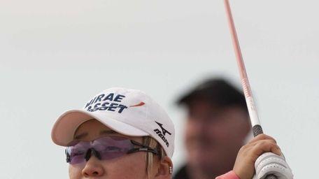 Korea's Jiyai Shin watches her drive off the