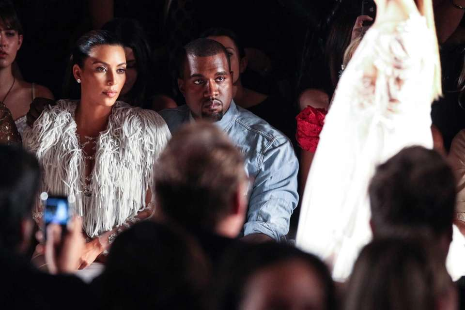 Kim Kardashian and Kanye West attend the Marchesa