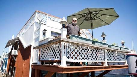 Howard Wasserman stands on the dining deck of