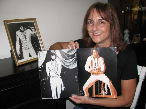 Joanne Petchonka-Foley with photos of Elvis Presley given