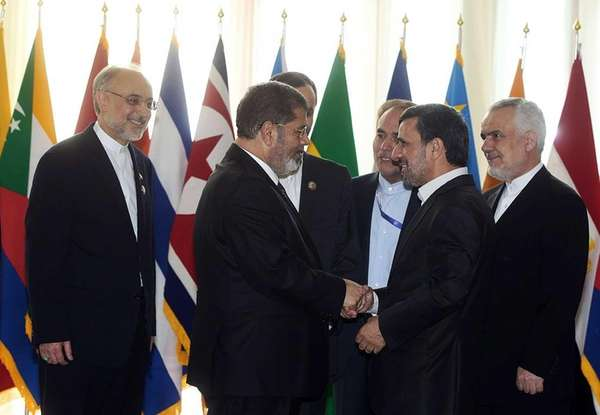 Iranian President Mahmoud Ahmadinejad, second right, welcomes Egyptian