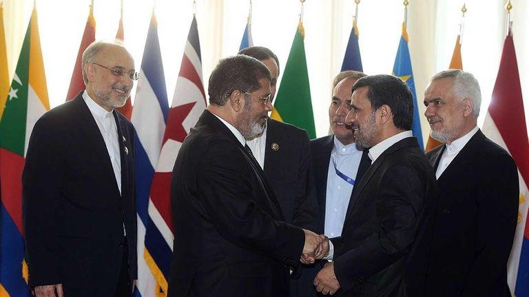 Iranian President Mahmoud Ahmadinejad, second right, welcomes Egyptian