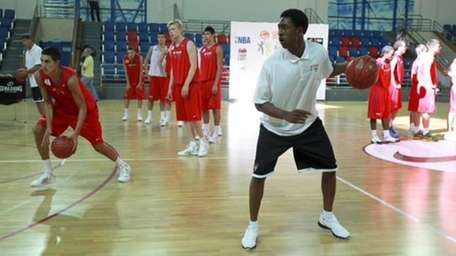 MarShon Brooks is participating in a Basketball without