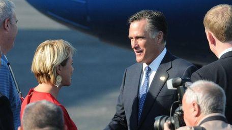 Mitt Romney greets Trish Bergin Weichbrodt, deputy supervisor