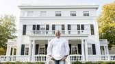 Tom Colicchio stands outside Topping Rose House on