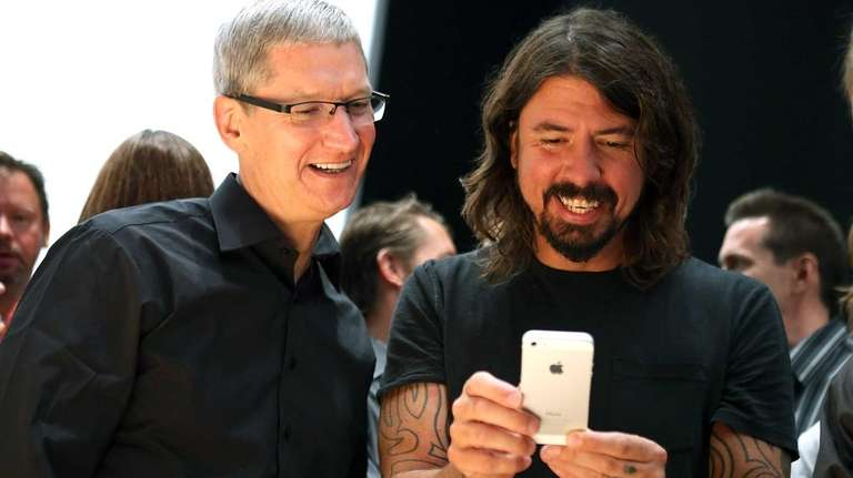 Apple chief executive Tim Cook, left, joins Dave