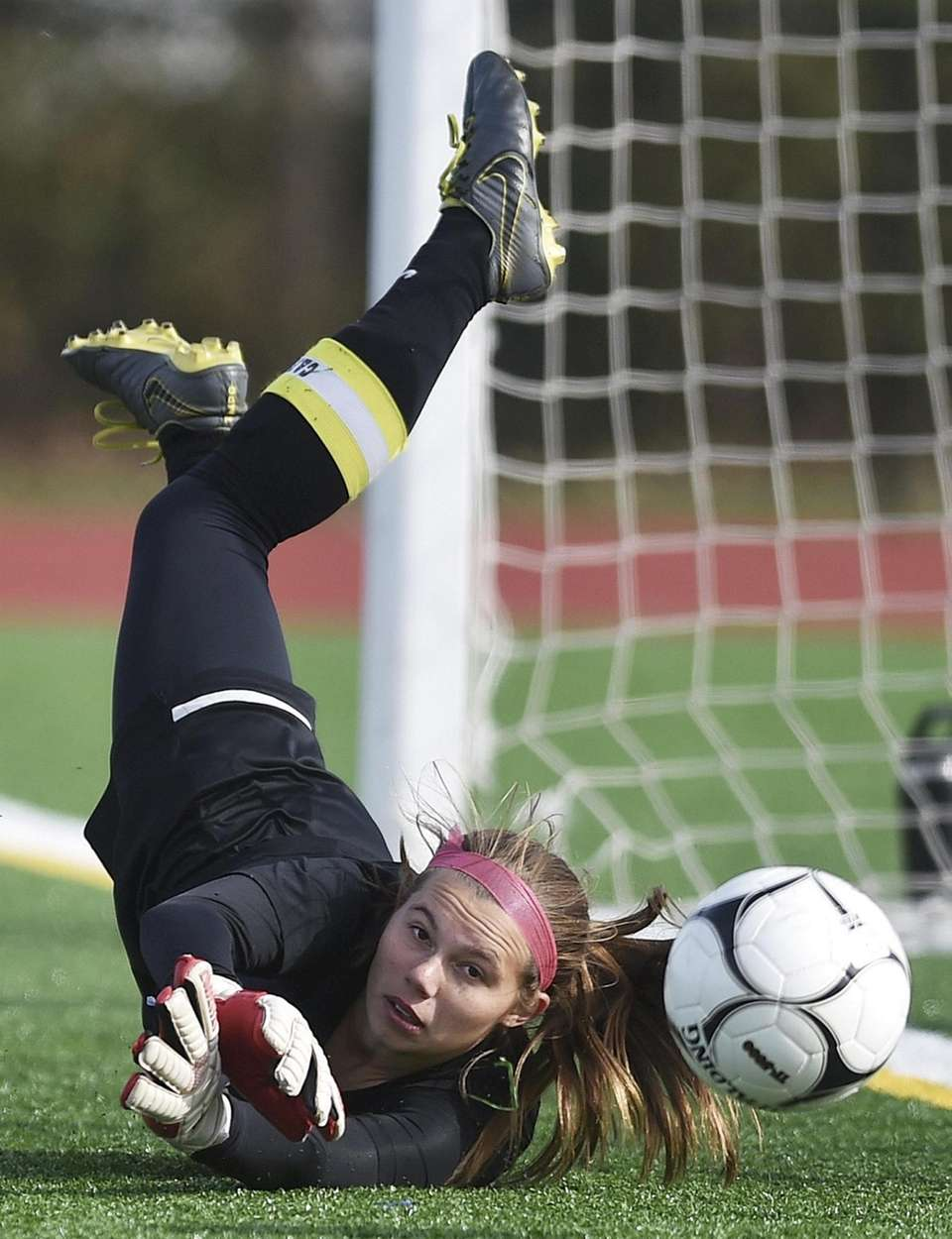 Alison Devall, Shoreham-Wading River goalie, makes a save