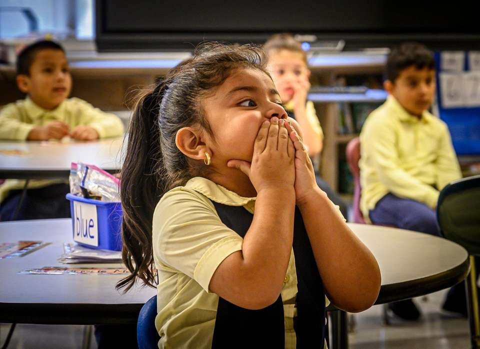 Kindergarten student Marjorie Mejia reacts to seeing the