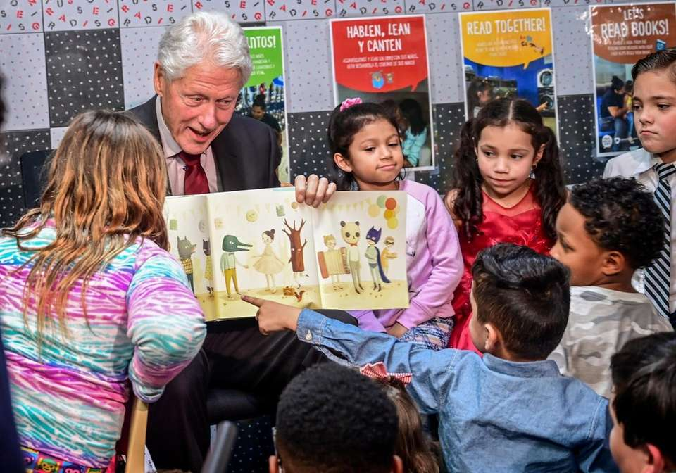 Former President Bill Clinton Reads to children at