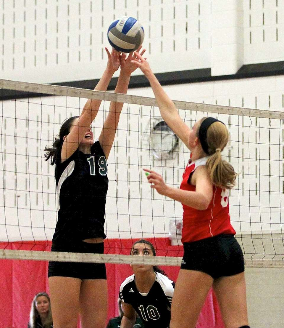 Connetquot's Katie Baker gets her shot blocked by