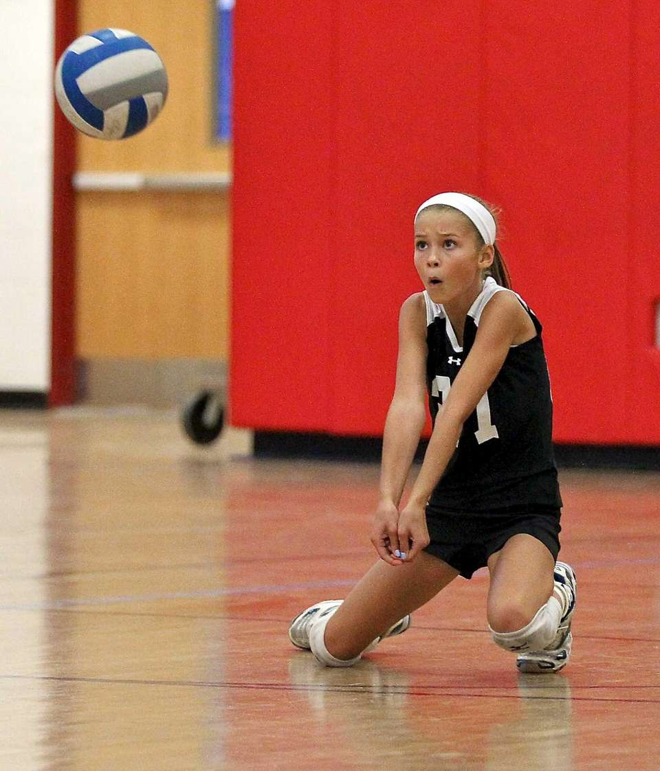 Connetquot's Mackenzie Cole goes for the dig in