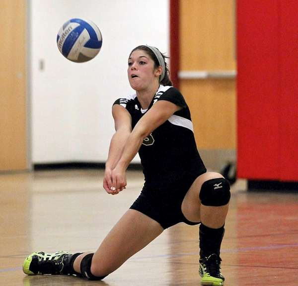 Lindenhurst's Rachel Ramirez goes for the dig during