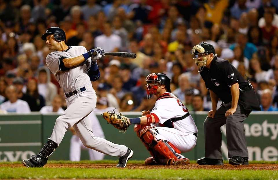 Derek Jeter hits an RBI single during the