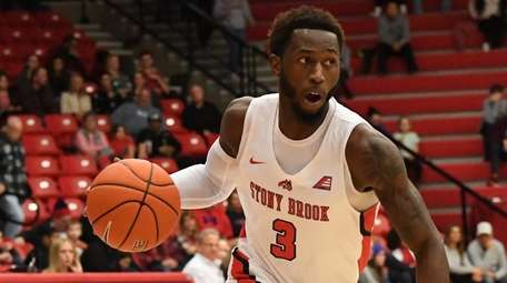 Stony Brook guard Elijah Olaniyi drives the ball
