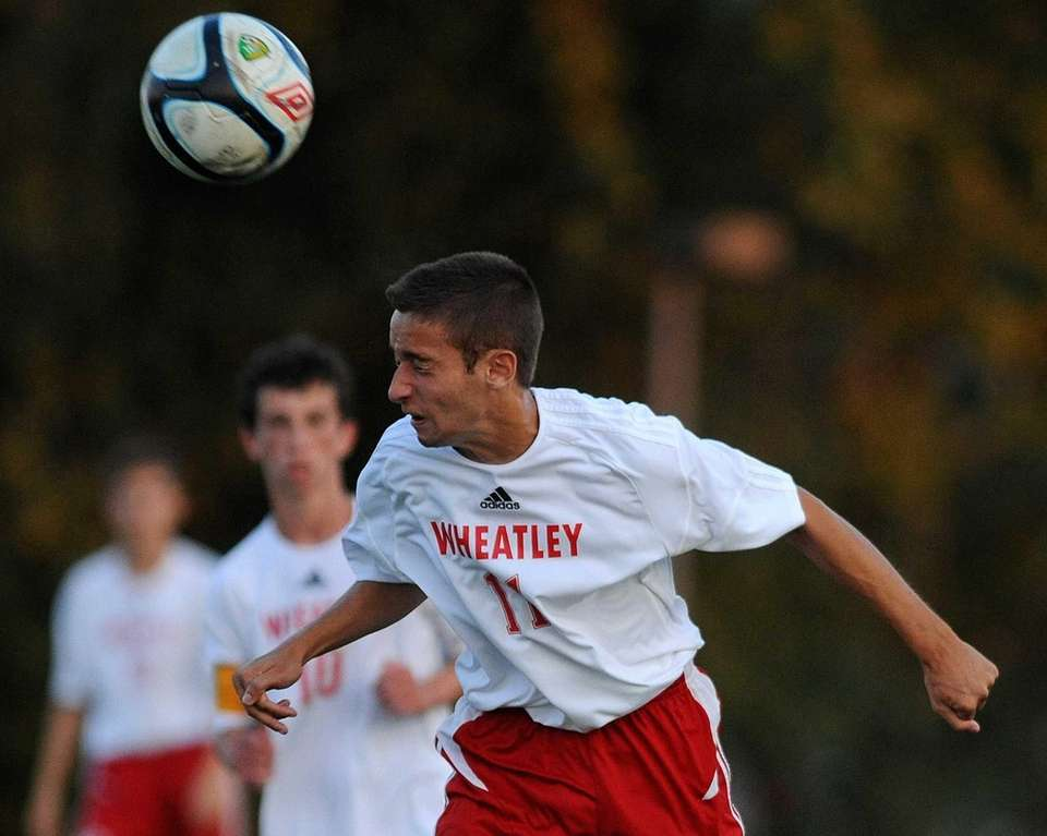 Wheatley's Matthew Huhn heads the ball in the