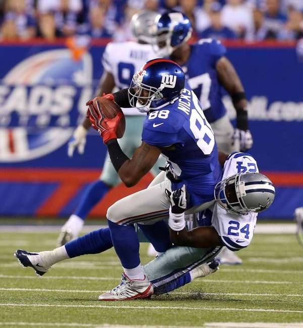 Hakeem Nicks gets tackled by Dallas Cowboys defensive