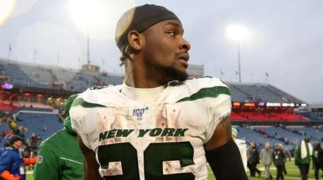 Le'Veon Bell of the Jets walks off the