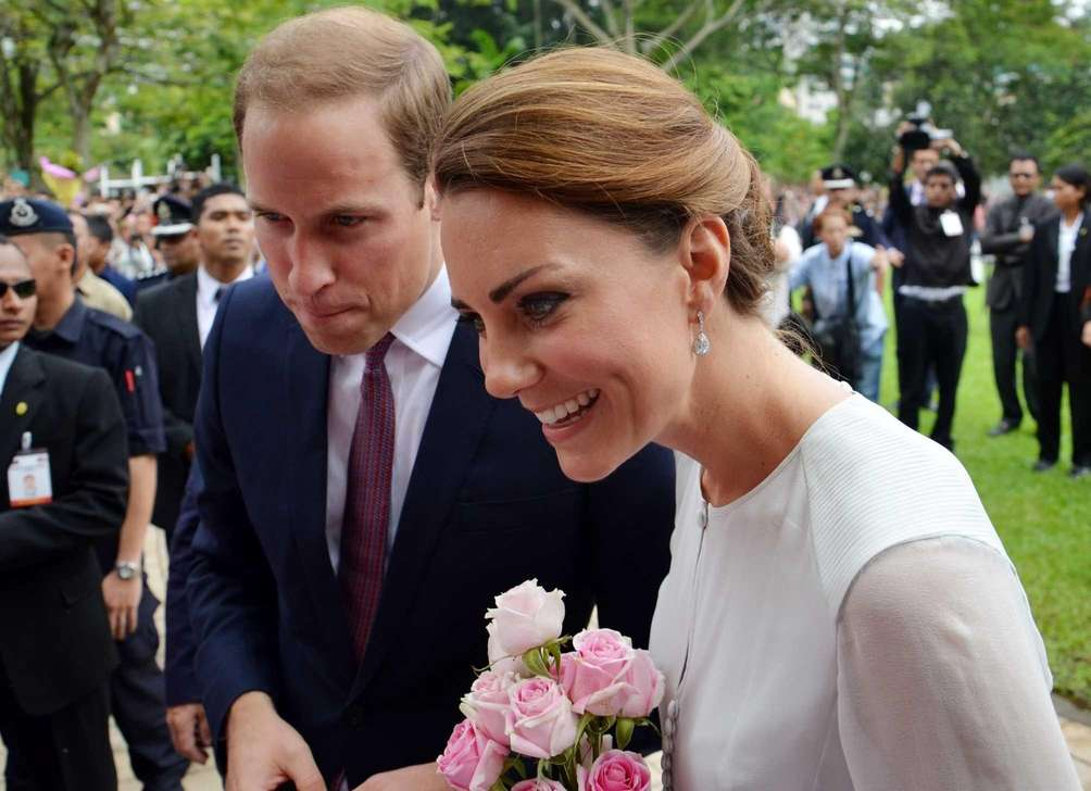Britain's Prince William and his wife Kate smile