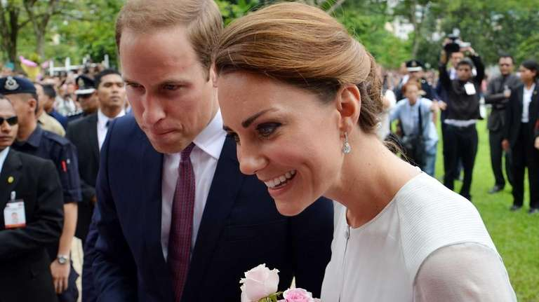 Prince William and his wife Kate smile to