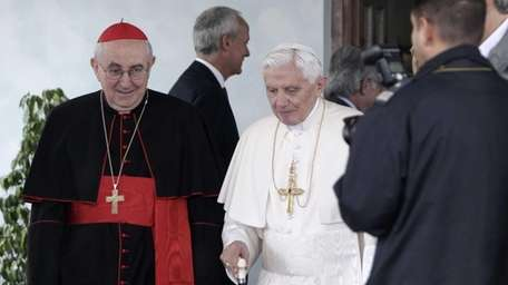 Pope Benedict XVI, center, flanked by cardinal vicar