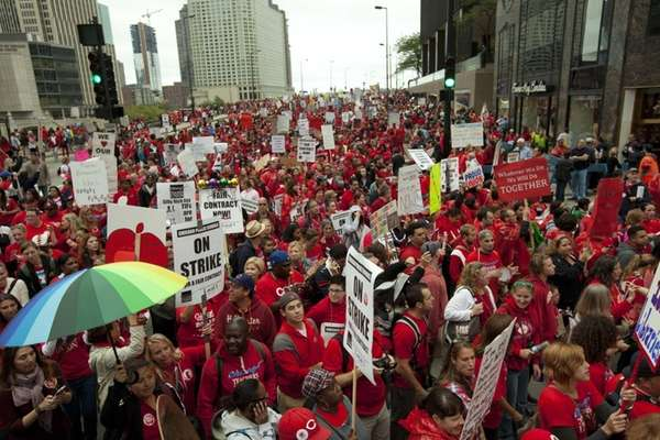 Thousands of striking public school teachers and their
