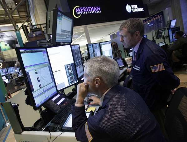 A pair of traders work in their booth