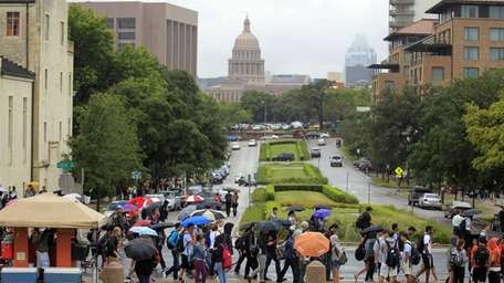 University of Texas students evacuate the campus after