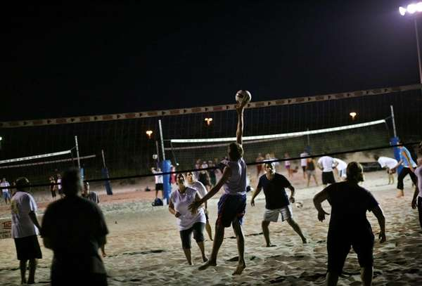 Beach volleyball is a big draw at night.