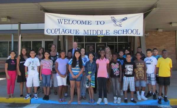 Copiague Middle School principal Andrew Lagnado, rear center,