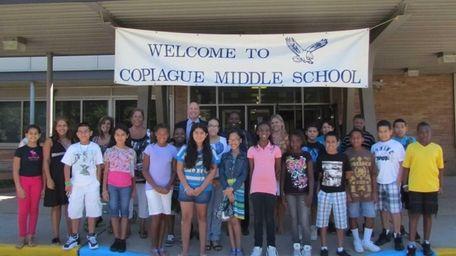Copiague Middle School principal Andrew Lagnado, rear center,