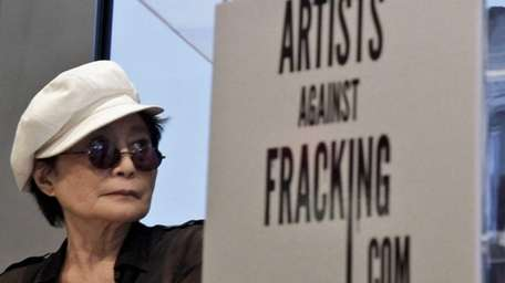 Yoko Ono appears at a news conference to