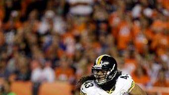 Pittsburgh Steelers strong safety Troy Polamalu defends against