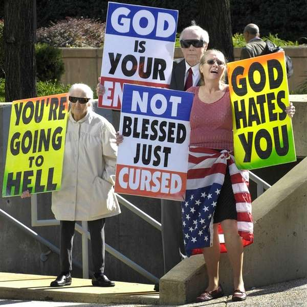 Members of the Westboro Baptist Church protest outside