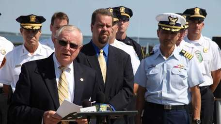Suffolk County District Attorney Thomas Spota stands with