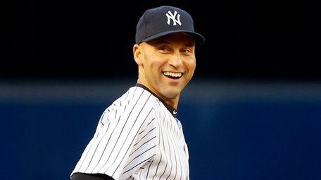 Derek Jeter of the Yankees looks on before