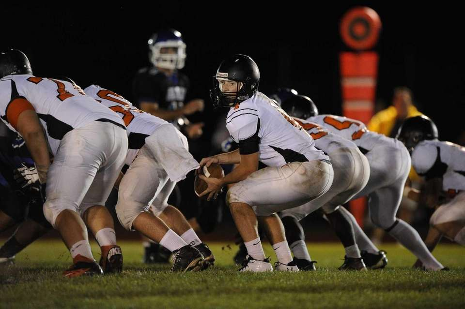 Babylon quarterback Nick Santorelli receives the snap at