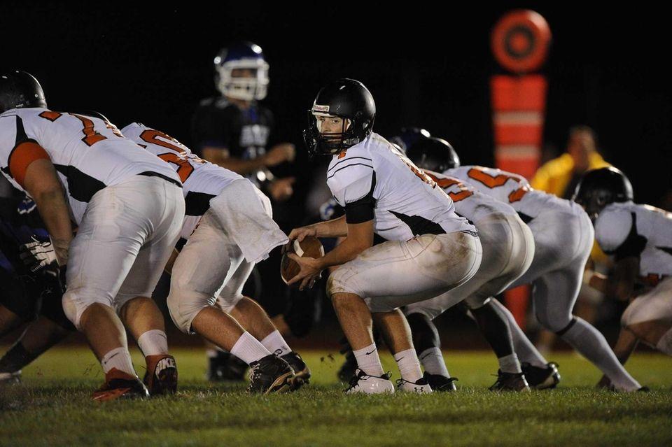 Babylon quarterback Nick Santorelli receives the snap at
