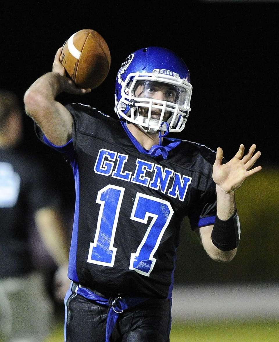 John Glenn quarterback Matt Shanerman warms up before