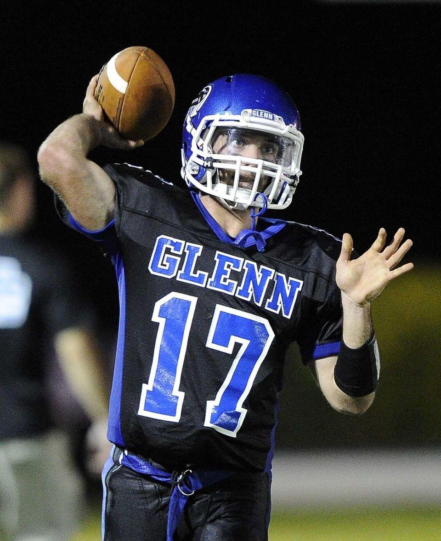 John Glenn quarterback Matt Shanerman warms up before
