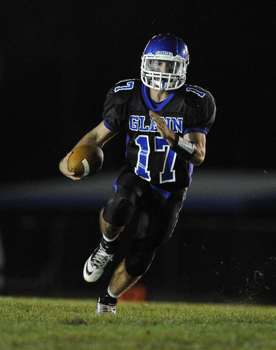 John Glenn quarterback Matt Shanerman drives the ball