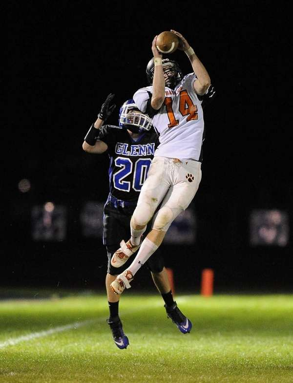 Babylon wide receiver Jake Carlock completes the catch