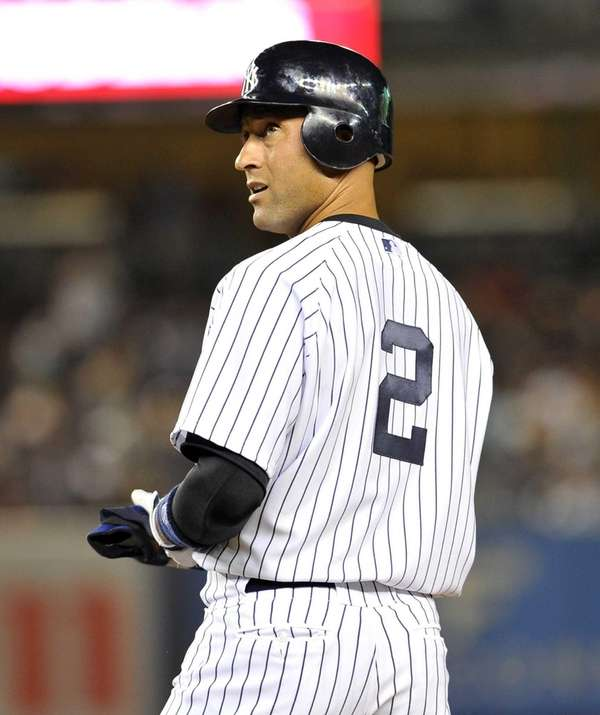 Derek Jeter stands at first base after passing