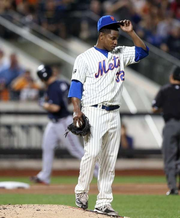 Jenrry Mejia looks on after surrendering a ninth-inning
