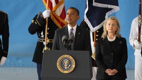 U.S. President Barack Obama, left, speaks as U.S.